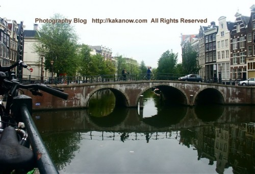 Arch bridge on the canal in Amsterdam. The Netherland travel, Photo by kaka.
