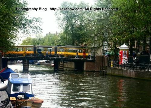 Rail bus on bridge in Amsterdam city. The Netherland travel. Photo by kaka.
