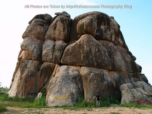 China travel, Inner Mongolia, Horqin Prairie. A huge stone in the prairie. Photo by KaKa.