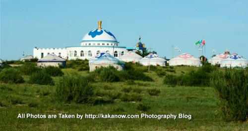 China travel, Inner Mongolia, Horqin Prairie, yurt-style building in the reservoir side. Photo by KaKa.