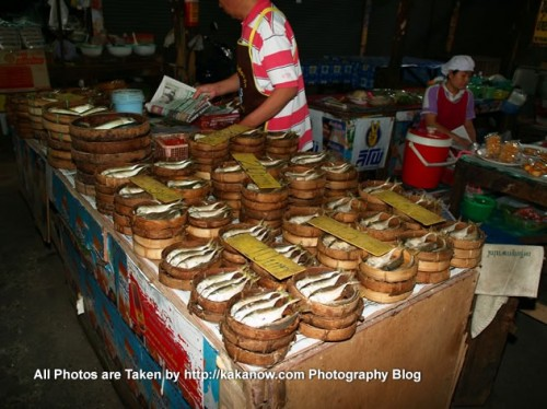 Thailand travel, a traditional market in Chiang Mai. These seem to be a kind of fermented fish. Photo by KaKa.